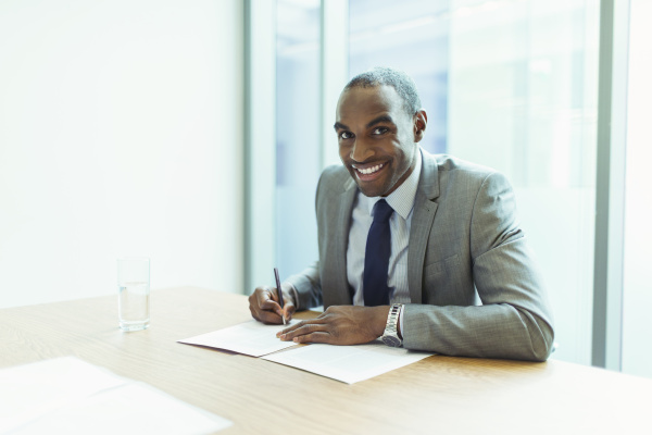businessman smiling at conference table