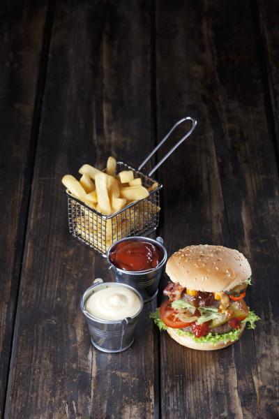 large hamburger with fries mayonnaise and
