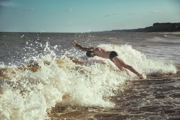 brazil bahia man jumping into the