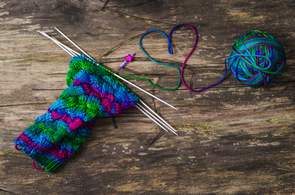 colorful socks wool and knitting needles