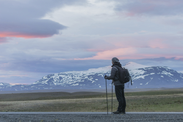 iceland man standing on road