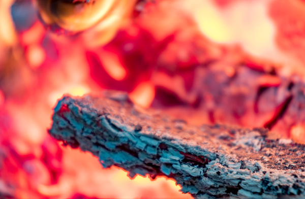 wood fire burning embers in close