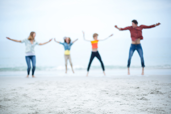 defocused image of family jumping at