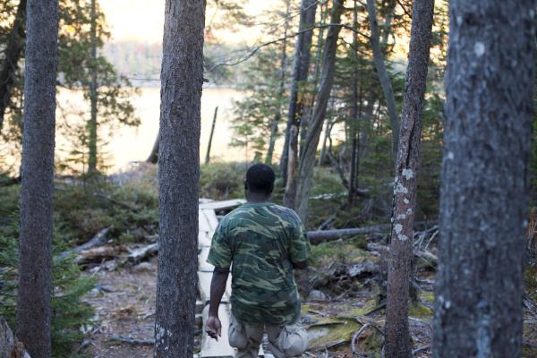 man walking on path around jordan