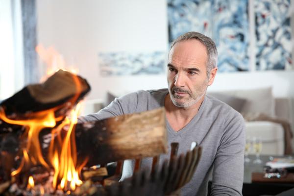 mature man in modern house preparing