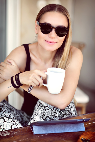 stylish woman at outdoor cafe