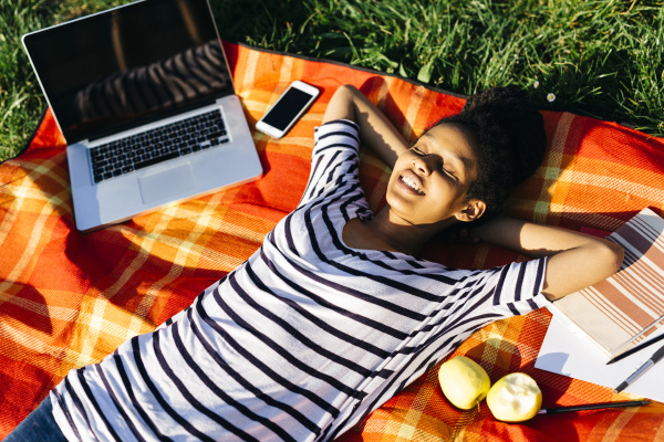 woman relaxing on blanket on a