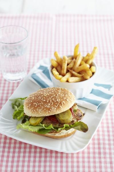 a mackerel burger with chips