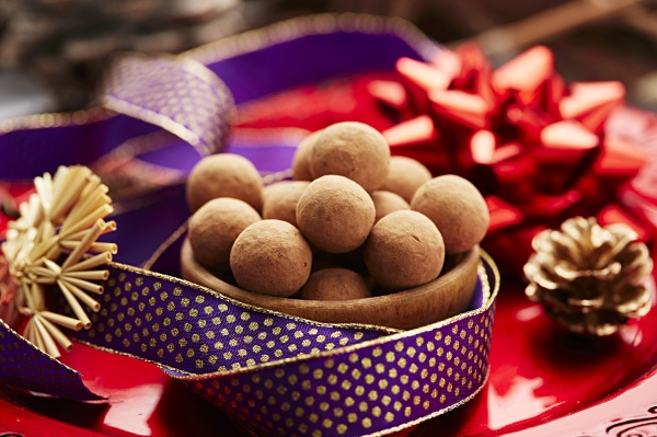 a bowl of chocolate truffles on