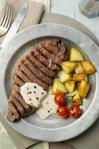 grilled steak with a pepper sauce