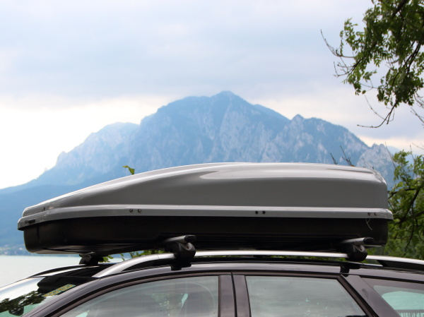 car rooftop box with mountain and