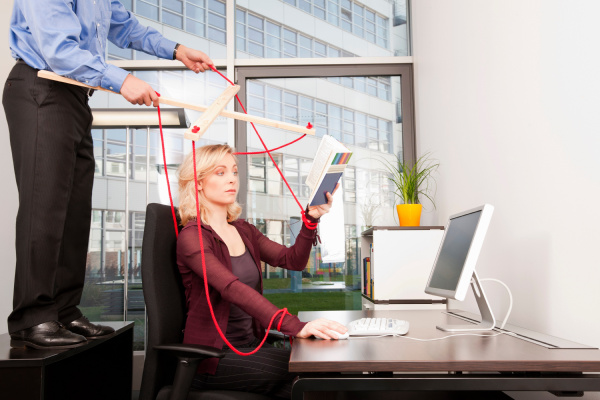 boss coordinating employee at desktop