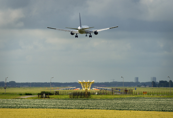 an aeroplane approaching schiphol amsterdam airport