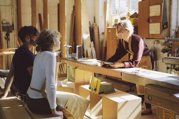 three craft workers having an informal