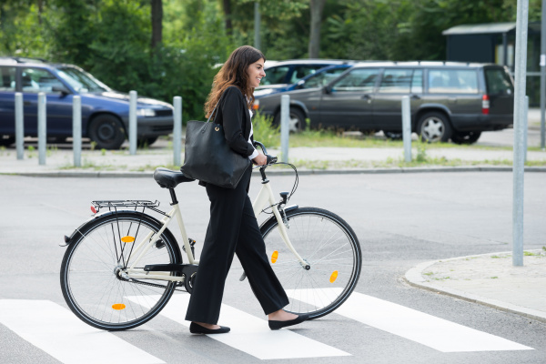 smiling businesswoman with handbag commuting on