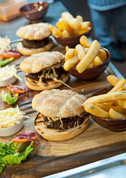 plates of burgers and french fries