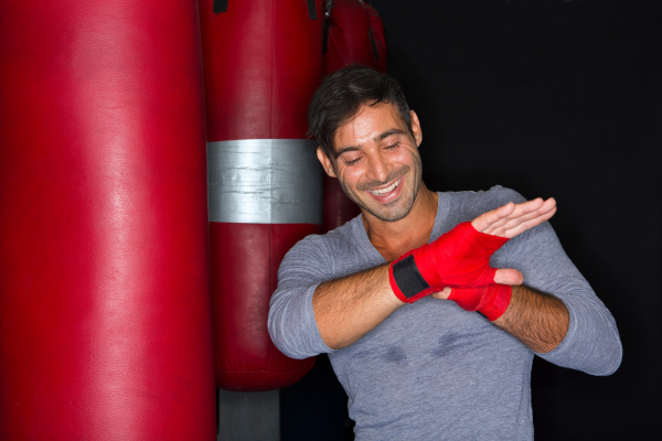 boxer wrapping his hands in gym