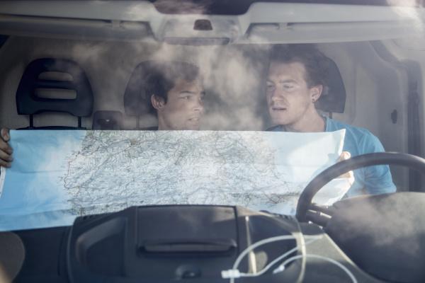 view through windscreen of young men