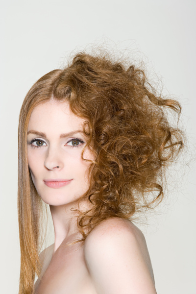 a woman with straight and curly