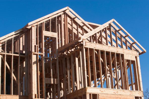 wooden construction frame against blue sky