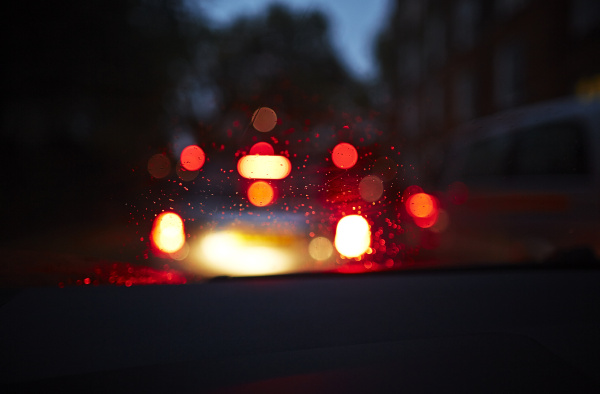 blurred tail lights of car at