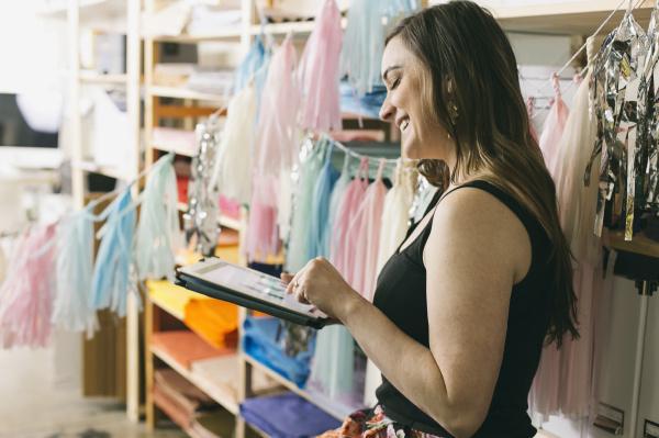 female designer using touchscreen on digital