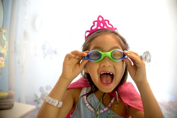 young girl wearing fancy dress costume