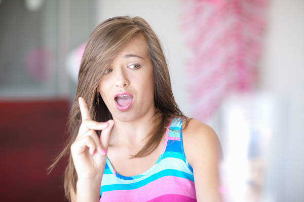 teenage girl wagging a finger