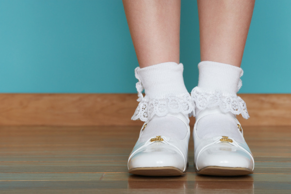 girl wearing white shoes