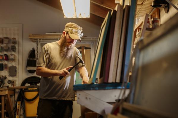 wood artist working in workshop using