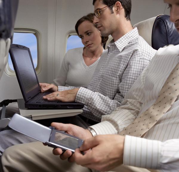 business people working on an aeroplane