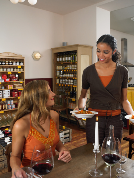 waitress bring food to couple in
