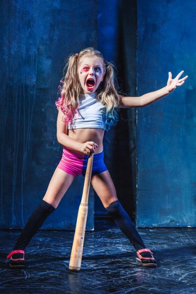 little girl pointing in toy gun