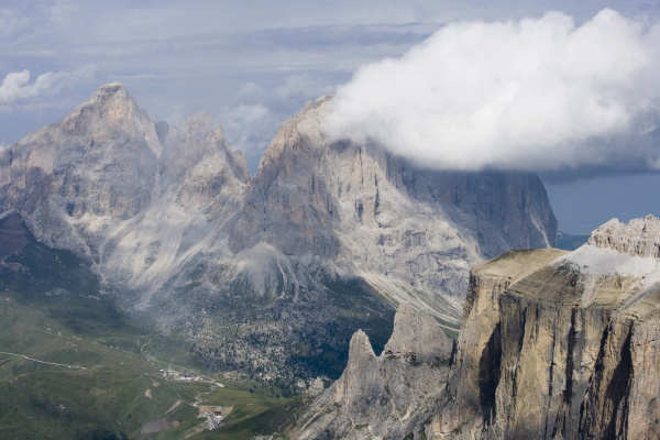 clouds over sassolungo mountains from gruppo