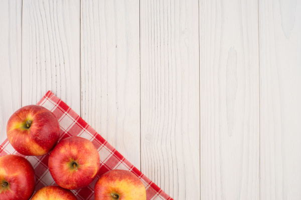 red apples on the old wooden