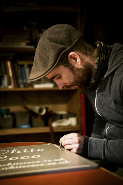 a sign writer working with a