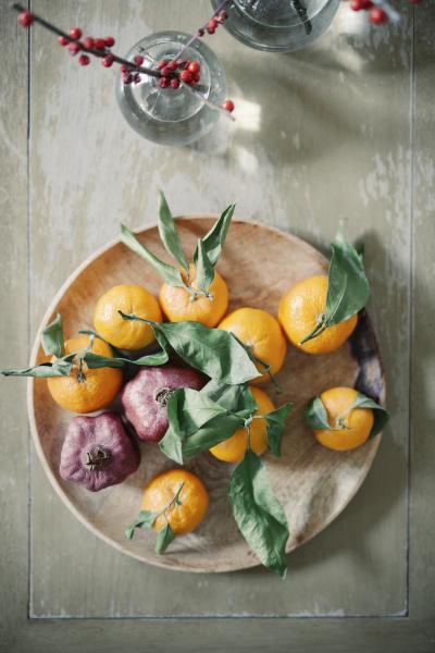 a wooden bowl of oranges citrus