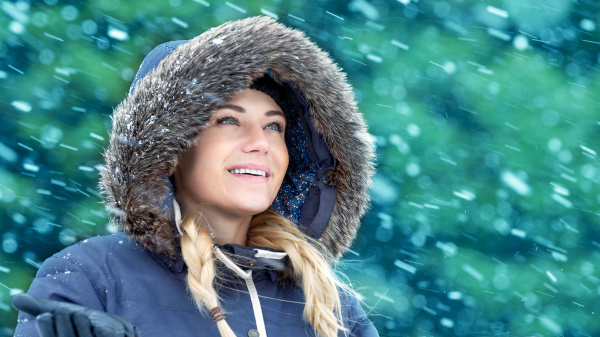 happy woman in winter park