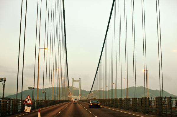traffic traveling along a suspension bridge