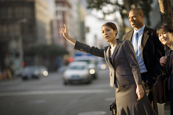 mid adult business woman hailing a