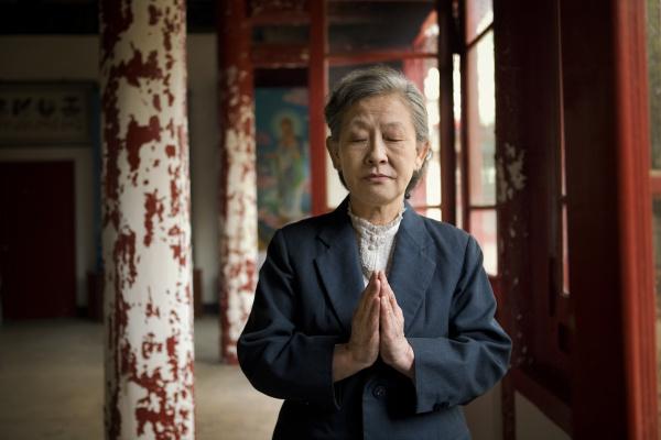 senior asian woman praying