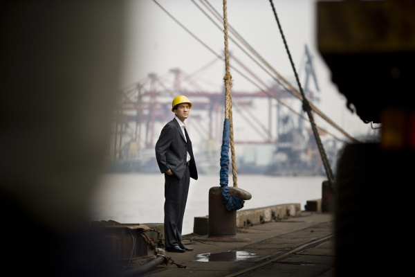 young adult businessman standing on a