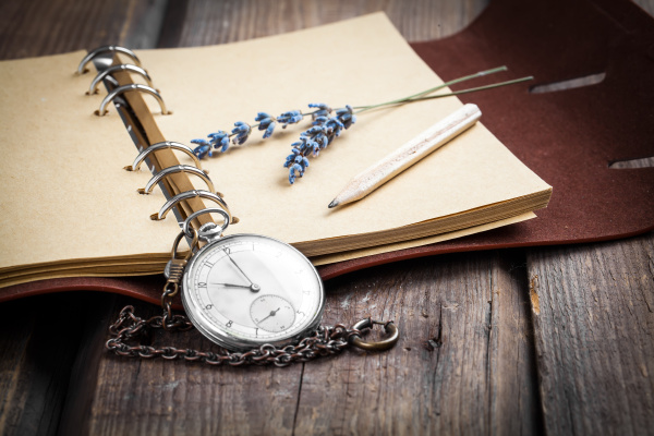 vintage writing pad with pocket watch