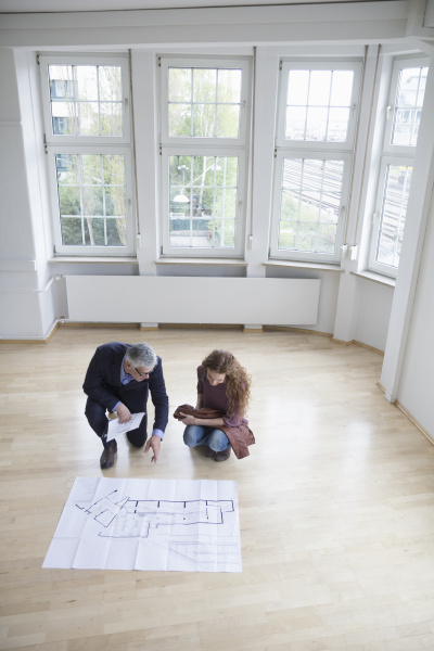 real estate agent showing construction plan