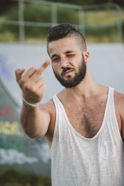 portrait of man giving the finger