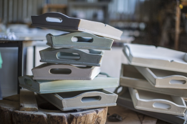 stack of wooden trays in workshop