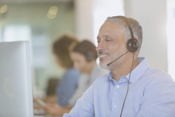 businessman with headset working at computer
