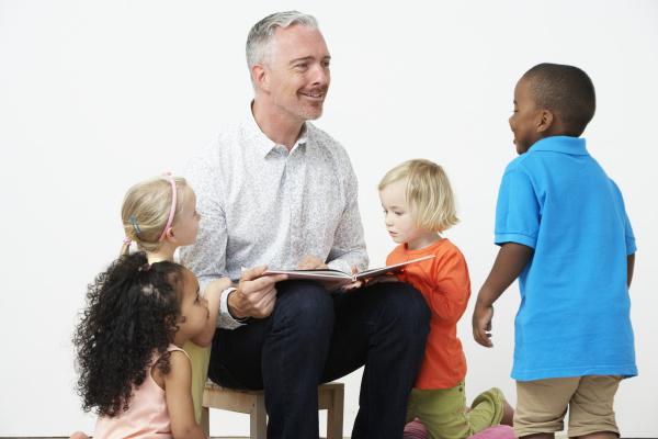 pre school teacher reading story to