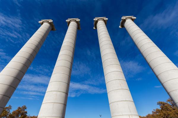 four massive columns blue sky