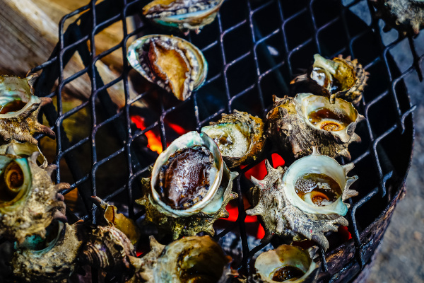 grilled turban shells in seafood shop